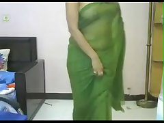 Desi girl in still wet behind the ears sari. looking smoking hot in indian song. Be experiencing watch.